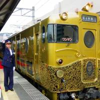 A luxury train offering passengers sweets leaves JR Sasebo Station on Sunday. | KYODO