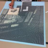An employee of Osaka municipal subway's Nishi-Umeda Station has spent 300 hours using tweezers to create mosaic-like artwork from the tiny pieces of paper punched out of tickets. | OSAKA MUNICIPAL TRANSPORTATION BUREAU
