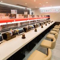 A sushi odyssey: Old-fashioned and bulky conveyer belts are being replaced by a more compact single-track systems and touchscreens at kaiten (conveyer belt) sushi restaurants in Tokyo. | COURTESY OF SUSHI NOVA