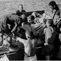 Sick Allied prisoners are put on a boat in September 1945 after the liberation of the Oeyama camp in Kyoto Prefecture, where Leland Chandler spent the last months of the war. | COURTESY OF MANSELL.COM