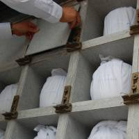The chambers holding each urn of remains are closed up at the city-run cemetery in Paju.