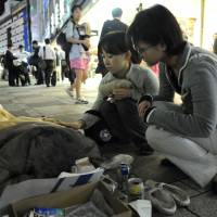 Medecins du Monde workers check up on the homeless in Tokyo. | MAHO HARADA