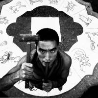 "A portrait of Yukio Mishima from Eikoh Hosoe's ""Ordeal by Roses"" collection 