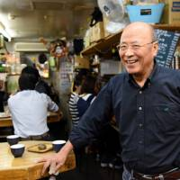 Yukihisa Ota, owner of Matsuso in Tokyo's Yurakucho district, is dismayed by how commercialized the area has become. | SATOKO KAWASAKI