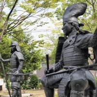 A man's man: Warlord Oda Nobunaga (1534-1582), immortalized here on the right in statue form in Nagoya, is widely believed to have preferred male sexual company, but he relied on concubines to sire a number of offspring. These children were then often deployed strategically to cement alliances. | KYODO