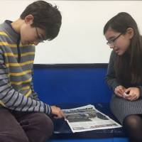 Life lessons: Two students discuss the Paris terrorist attacks at a Tokyo international school. Such tragic events can also be educational opportunities for parents and teachers to introduce issues from conflict resolution to discrimination.   TERU CLAVEL