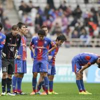 FC Tokyo players react after the team's 0-0 home draw against Sagan Tosu on Sunday. | KYODO