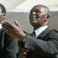 Track legend and IOC executive member Kip Keino (right), the Kenyan National Olympic Committee president, seen in a 2008 file photo, fears that his country could face a competition ban due to a sharp rise in failed drug tests in recent years. | AP