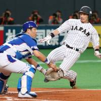 Fukuoka Softbank's Nobuhiro Matsuda, seen playing for Japan against South Korea at the Premier 12 in Sapporo on Sunday, has filed for international free agency. | KYODO