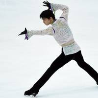 Yuzuru Hanyu performs during the men's free skate on Saturday at the NHK Trophy in Nagano. Hanyu captured the title with a world-record score of 322.40 points in the two-day competition. | AFP-JIJI
