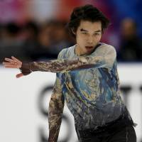 Takahito Mura performs during the men's free skate at the NHK Trophy on Saturday. He placed third overall in the two-day men's competition. | REUTERS