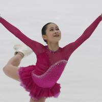 Satoko Miyahara competes during the women's free skate on Saturday at Nagano's Big Hat. Miyahara, who led after the short program, won the women's competition with 203.11 points. | AP
