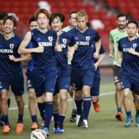 Members of the Japanese national team run during a training session on Wednesday in Singapore. | KYODO