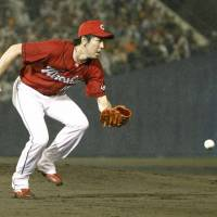 Hiroshima Carp pitcher Kenta Maeda is a Central League Golden Glove winner for the fourth straight season. | KYODO