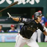 Japan's Shogo Akiyama hits a two-run homer against Puerto Rico during the third inning of their game on Thursday in Fukuoka. Japan won 8-3. | KYODO