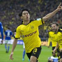 Kagawa on target as Dortmund wins derby thriller