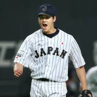 Japan starter Shohei Otani reacts after a strikeout during the opening game of the Premier 12 on Sunday in Sapporo. | KYODO