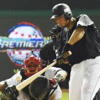 Sho Nakata connects for a two-run double against the Dominican Republic in the eighth inning of their Premier 12 game on Thursday night in Taoyuan, Taiwan. Japan won 4-2. | KYODO