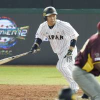 Akira Nakamura hits a sayonara single to left during the ninth inning of Japan's victory over Venezuela during the preliminary round of the Premier 12 on Sunday. | KYODO