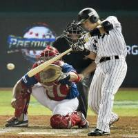 Motohiro Shima strokes an RBI single in the seventh inning against Puerto Rico in the quarterfinals of the Premier 12 tournament in Taoyuan, Taiwan, on Monday night. Japan won 9-3. | KYODO