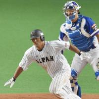 Ryosuke Hirata drives in a run during the fifth inning of Japan's victory over Korea on Sunday night. | KYODO