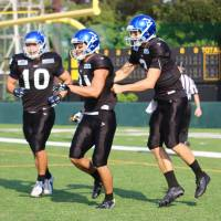 IBM quarterback Kevin Craft (right) celebrates after wide receiver Takashi Kurihara caught a touchdown pass against Asahi Beer in early October in Kawasaki. Craft became the first American to play quarterback in the X League in 2012. KAZ NAGATSUKA