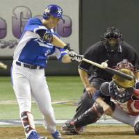 South Korea's Kim Hyun-soo hits a double in the fourth inning of Saturday's Premier 12 final against the United States at Tokyo Dome. | KYODO