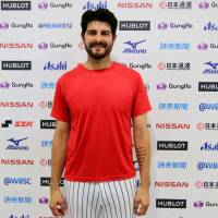 Mexico pitcher Mark Serrano stands in the mixed zone after his team's 9-6 win over the Dominican Republic at the Premier 12 in Taoyuan, Taiwan, on Sunday. | KAZ NAGATSUKA