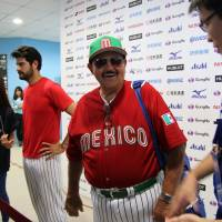 Mexico manager Juan Gabriel Castro (right) and Mark Serrano address the media in the mixed zone after the team's 9-6 win over the Dominican Republic on Sunday. | KAZ NAGATSUKA