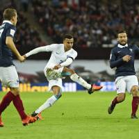 Dele Alli (center) scores England's first goal in Tuesday's friendly against France. | REUTERS