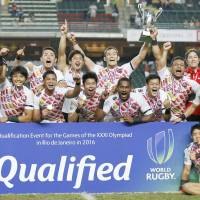 Japan's rugby sevens team celebrates after punching a ticket to the Rio Olympics on Sunday in Hong Kong. | KYODO