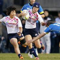 Japan's Mifuyu Koide runs at the Kazakhstan defense during the second leg of the Asian qualifiers for the Rio Olympics rugby sevens competition in Tokyo on Sunday. | KYODO