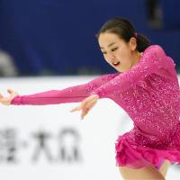 Mao Asada performs her short program at the Cup of China on Friday in Beijing. Mao received 71.73 points to win the short program. | KYODO