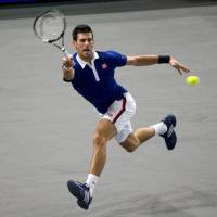 Djokovic moves into Paris semis