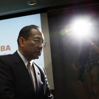 Toshiba Corp. President Masashi Muromachi leaves a news conference in Tokyo on Dec. 21 after announcing a record ¥550 billion loss forecast and job cuts. | BLOOMBERG