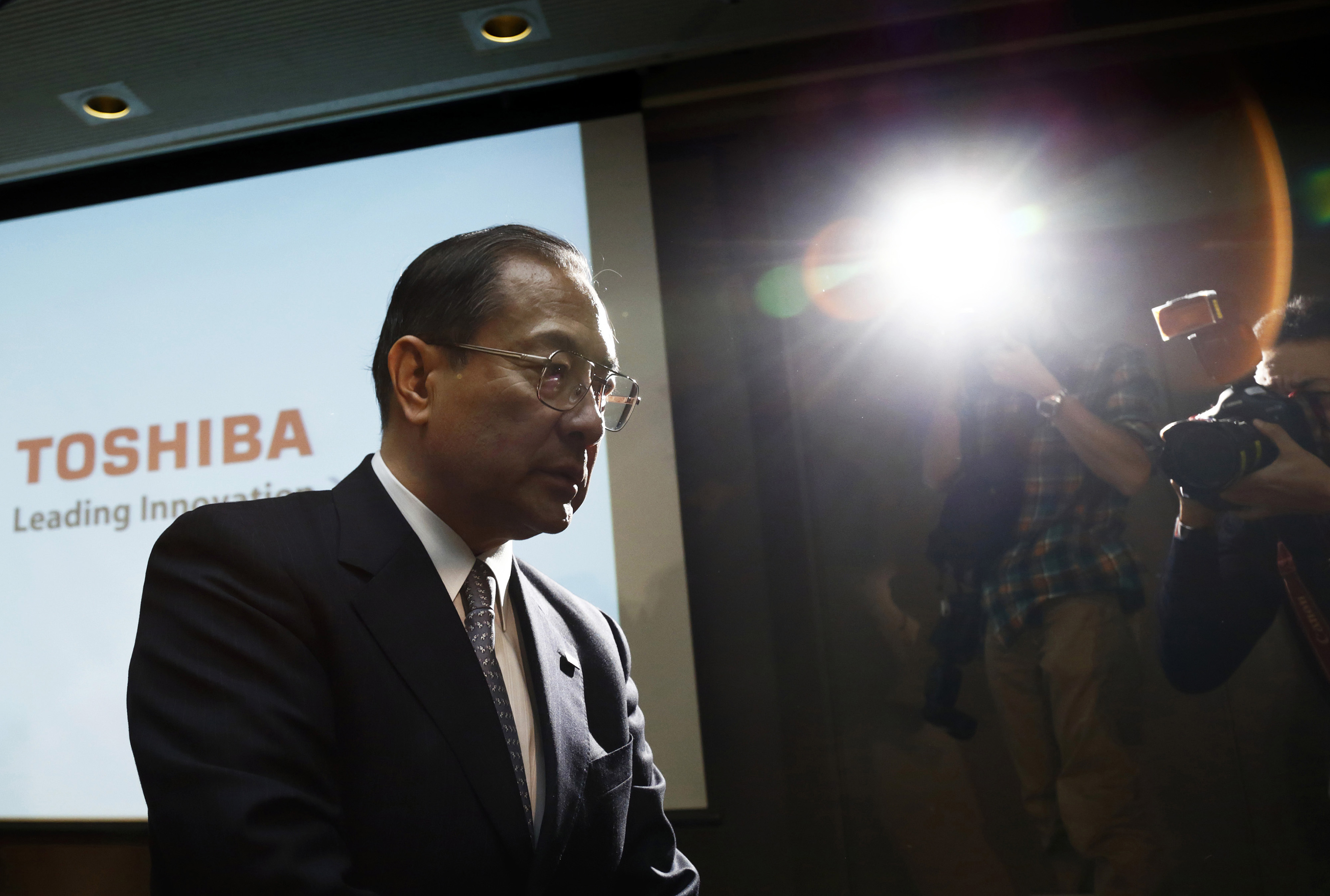 Toshiba Corp. President Masashi Muromachi leaves a news conference in Tokyo on Dec. 21 after announcing a record ¥550 billion loss forecast and job cuts.   BLOOMBERG