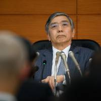 Bank of Japan Gov. Haruhiko Kuroda attends a news conference at the central bank's headquarters in Tokyo on Friday. | BLOOMBERG