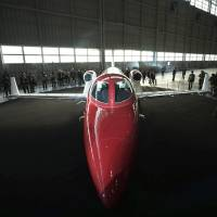 A HondaJet is displayed on April 23 at the venue of a press conference at Haneda international airport in Tokyo. Nearly 30 years after development began, and after more than a dozen years of testing, Honda, a company best known for its cars and motorcycles, is about to start delivering its first aircraft: a HondaJet. Japan-based Honda is expected to receive a crucial Federal Aviation Administration certification in December. | AP