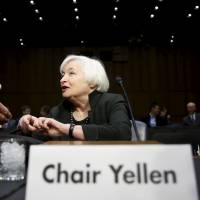 U.S. jobs report clears way for Fed interest rate hike