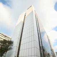 The building housing the headquarters of the Government Pension Investment Fund is seen in Tokyo's Kasumigaseki district Monday. The pension manager announced a ¥7.9 trillion loss for the three months through September. | KYODO