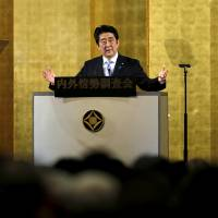 Prime Minister Shinzo Abe speaks at a lecture event in Tokyo on Monday. | REUTERS