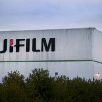 Fujifilm Holdings Corp. signage is displayed outside the company's production facility in Greenwood, South Carolina. The Japanese firm is interested in buying a medical equipment subsidiary of embattled Toshiba Corp., sources close to the matter said Wednesday. | BLOOMBERG