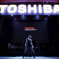 A dancer performs during a Toshiba product demonstration at the CEATEC Japan 2010 expo in Chiba. | REUTERS