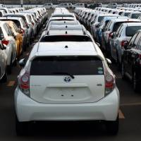 Toyota Motor Corp. vehicles await shipment at the port of Sendai, Miyagi Prefecture. The auto giant says it and it subsidiaries are targeting global sales of 10.11 million vehicles in 2016. | BLOOMBERG
