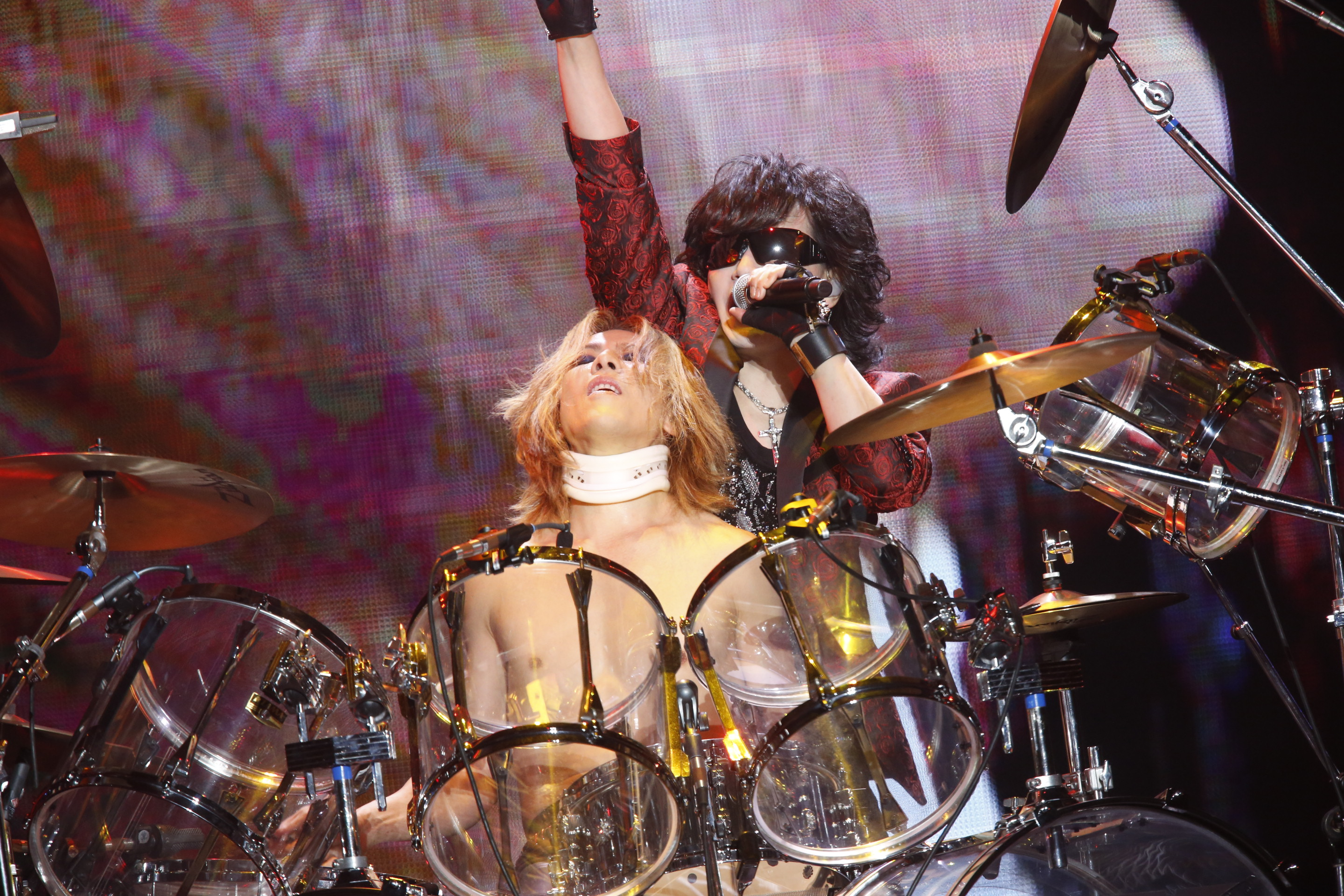 Staging a return: Yoshiki (on drums) and Toshl perform at Yokohama Arena as part of an X Japan tour on Dec. 1.