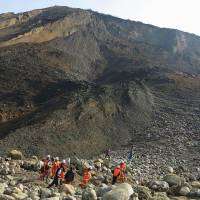 Only three missing in Myanmar jade mine landslide, not dozens, rescuers say