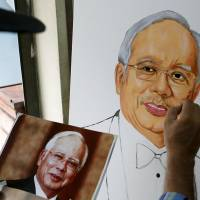 Malaysia's Najib says 'conscience clear' as funding scandal festers