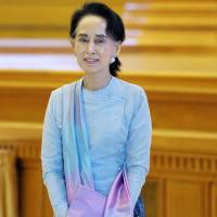 In first step to power, Suu Kyi holds talks with Myanmar president
