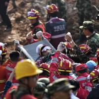 Man buried by China landslide found alive after more than 60 hours