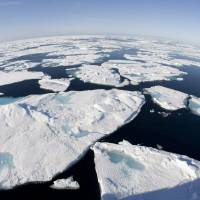 Global warming blamed as Arctic posts record heat over land, retreat of ice